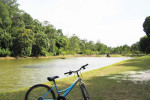 Recreational mountain bicycle against river and forest view