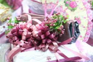 Pink ribbons and small flowers